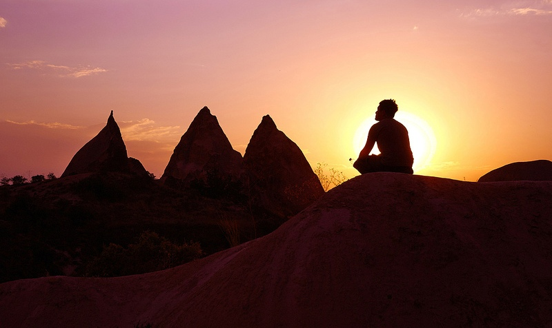 meditating-man-on-hill